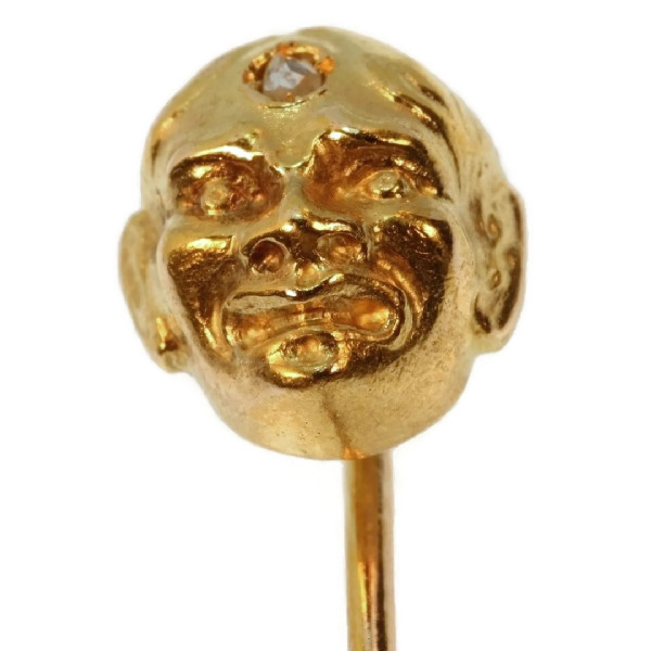 Art Nouveau gold tiepin mask with diamond as third eye